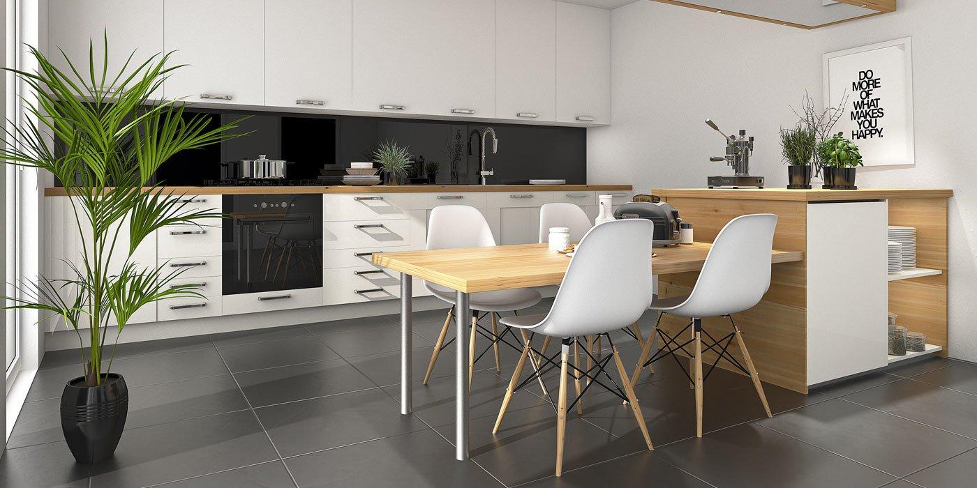 Eine moderne Küchenzeile, die zugleich ein Esstisch und Stühle beinhaltet