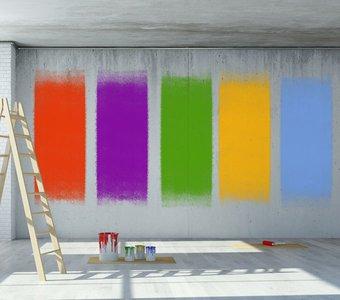 Buntes Muster an der Wand. Farbeimer stehen daneben